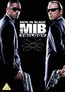 Cover of Men in Black Trilogy DVD set. Will Smith and Tommy Lee Jones hold sci-fi weapons.